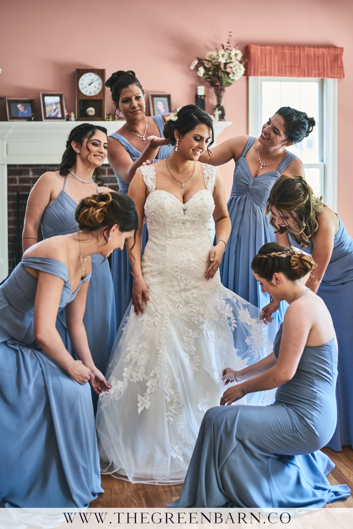 Bride Getting Ready with Bridesmaids in Blue Photo by Cate Bligh of The Green Barn Wedding Photography LLC