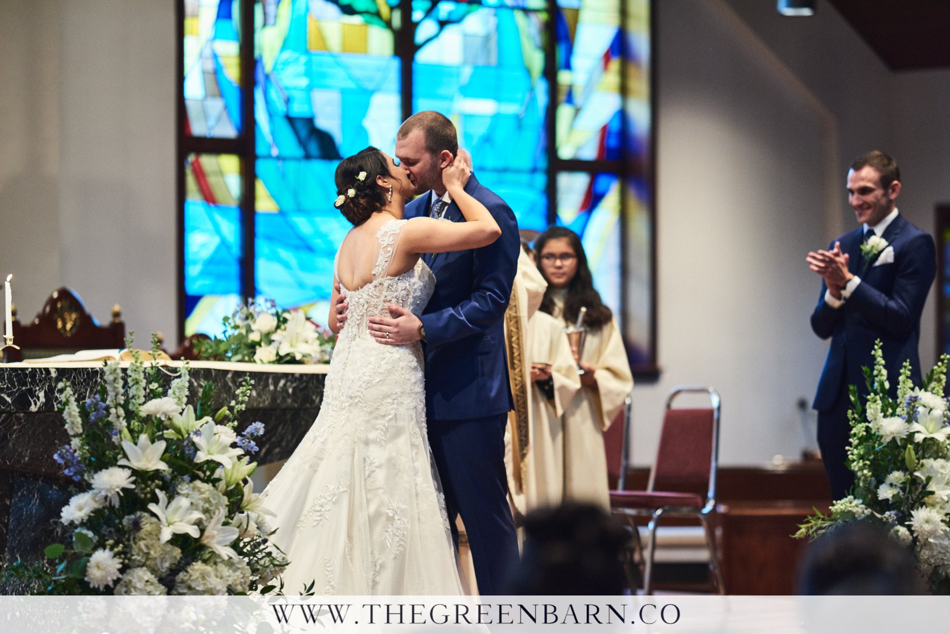 Bride and Groom First Kiss at a Church Ceremony at St Rose of Lima Parish Photo by Cate Bligh of The Green Barn Wedding Photography LLC