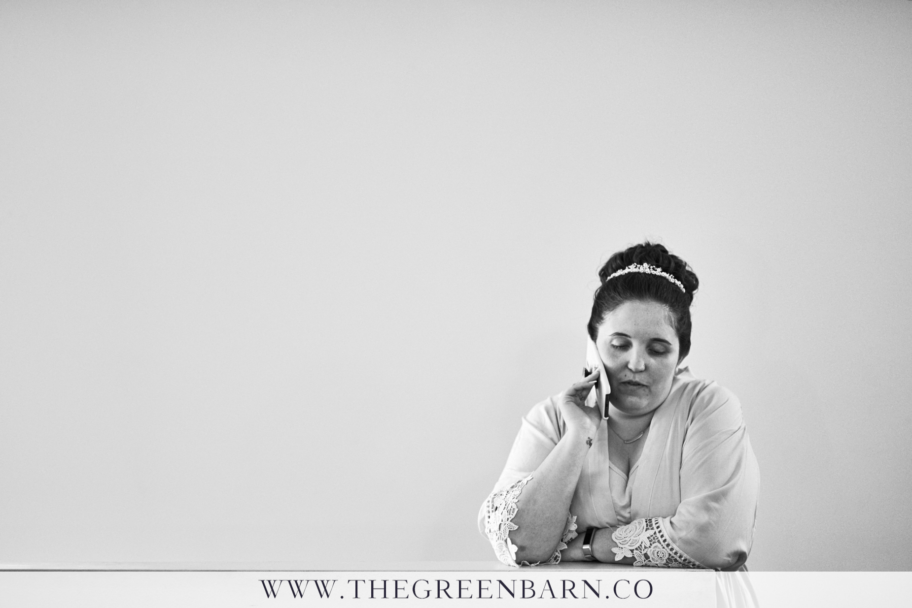 Bride Getting Ready and Talking on the Phone Black and White Wedding Photo by Cate Bligh