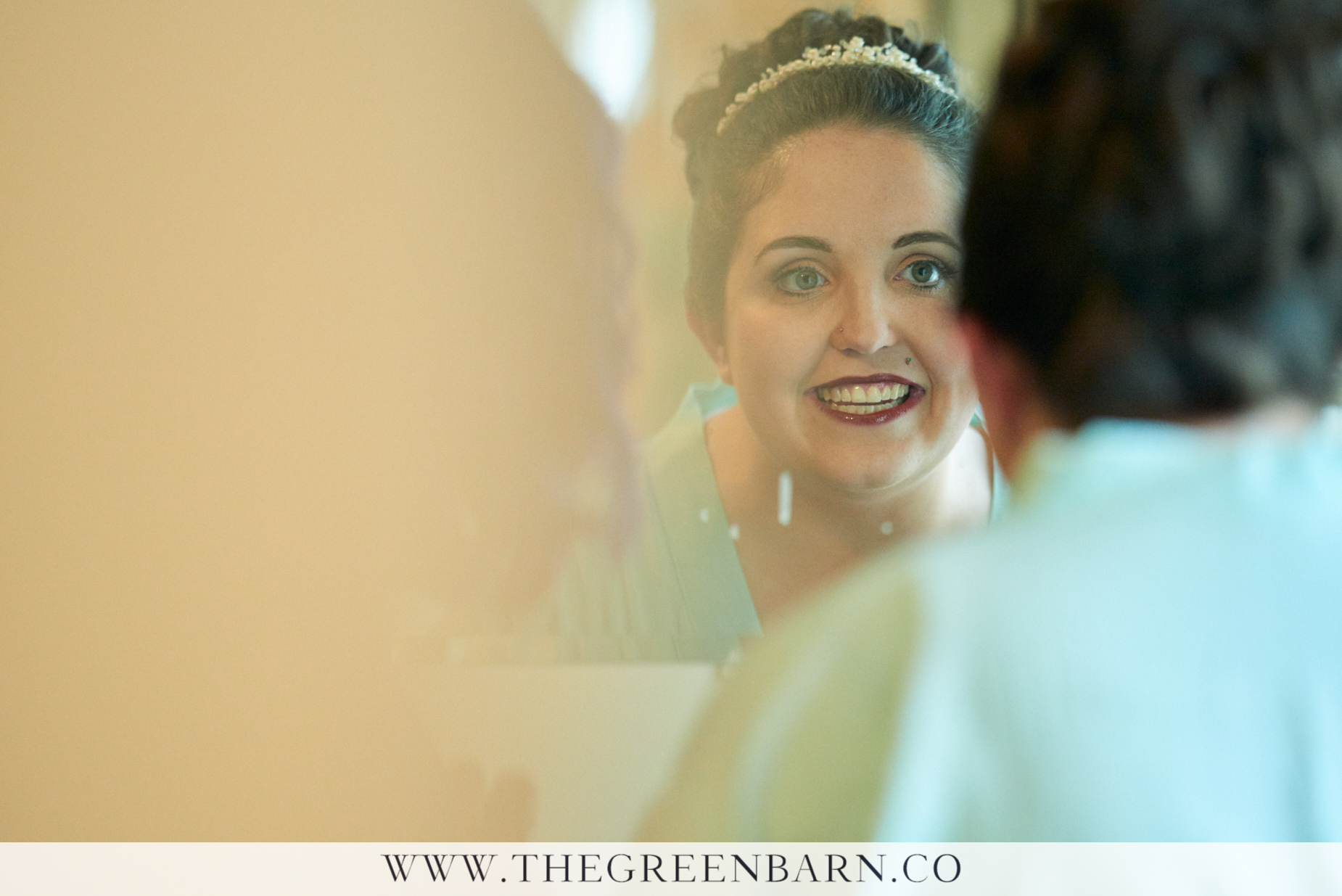 Bride Getting Ready and Checking Her Makeup in the Mirror on her Wedding Day in Williston Vermont