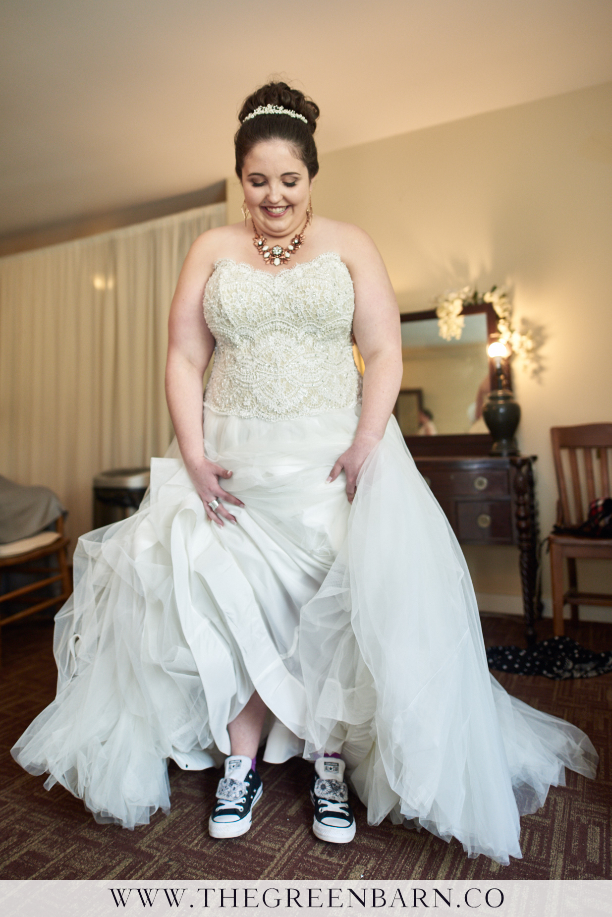 Bride Showing Off Her Converse All-Star's Wedding Shoes Photo By Cate Bligh