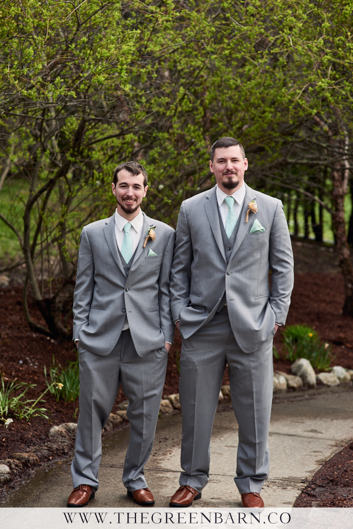Groom in Grey Suit with Sea Foam Green Tie and Pocket Square Photo with Groomsman