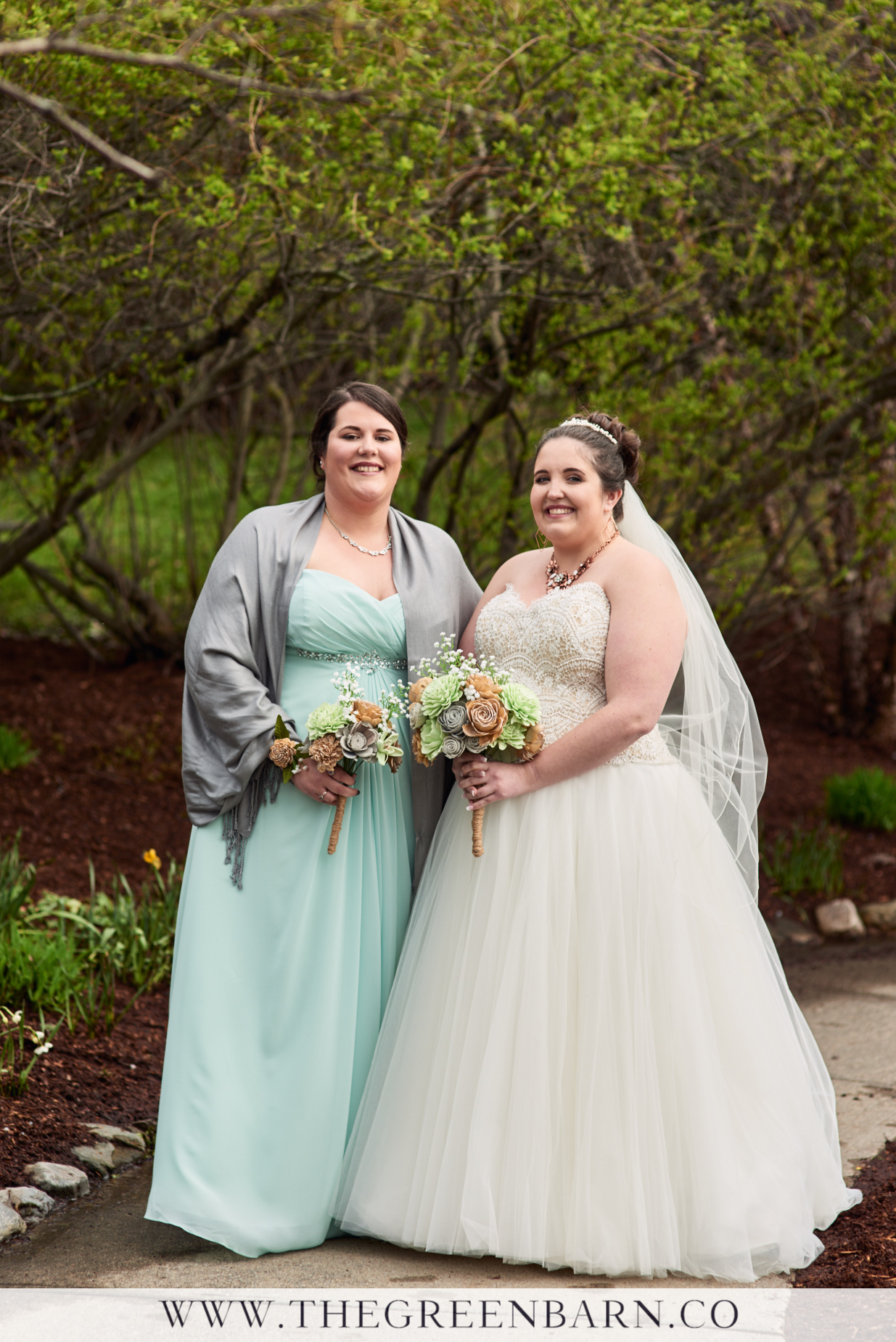Bride with Bridesmaid in Sea Foam Green Bridesmaid Dress for a Spring Wedding