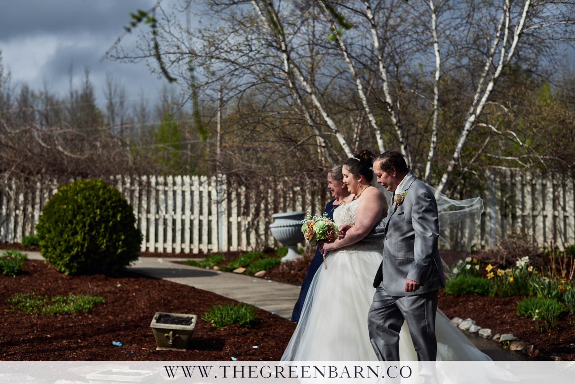 Bride is Escorted by Mom and Dad in the Garden Ceremony Space at Catamount Country Club in northern Vermont