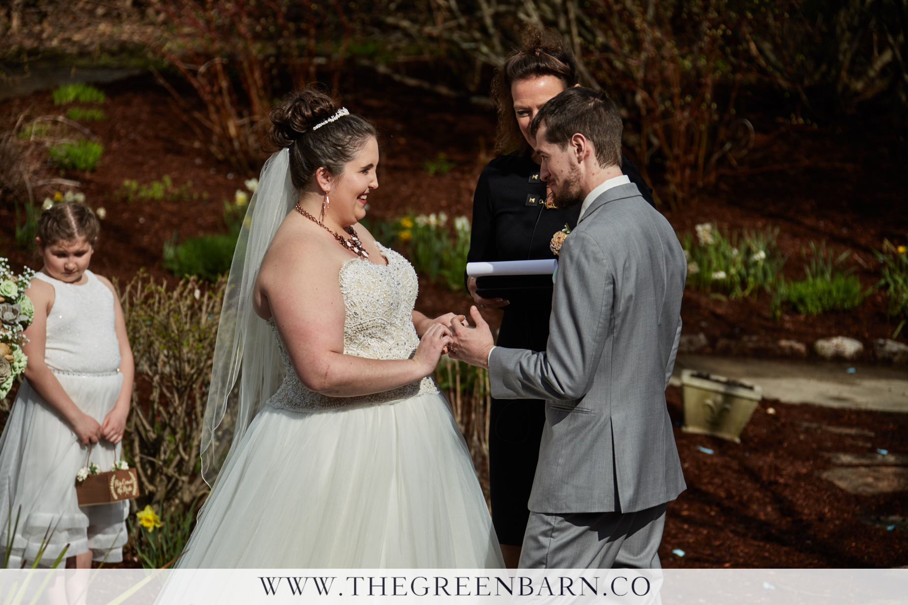 Bride and Groom Exchange Rings at their Garden Wedding Ceremony at Catamount Country Club in Northern Vermont