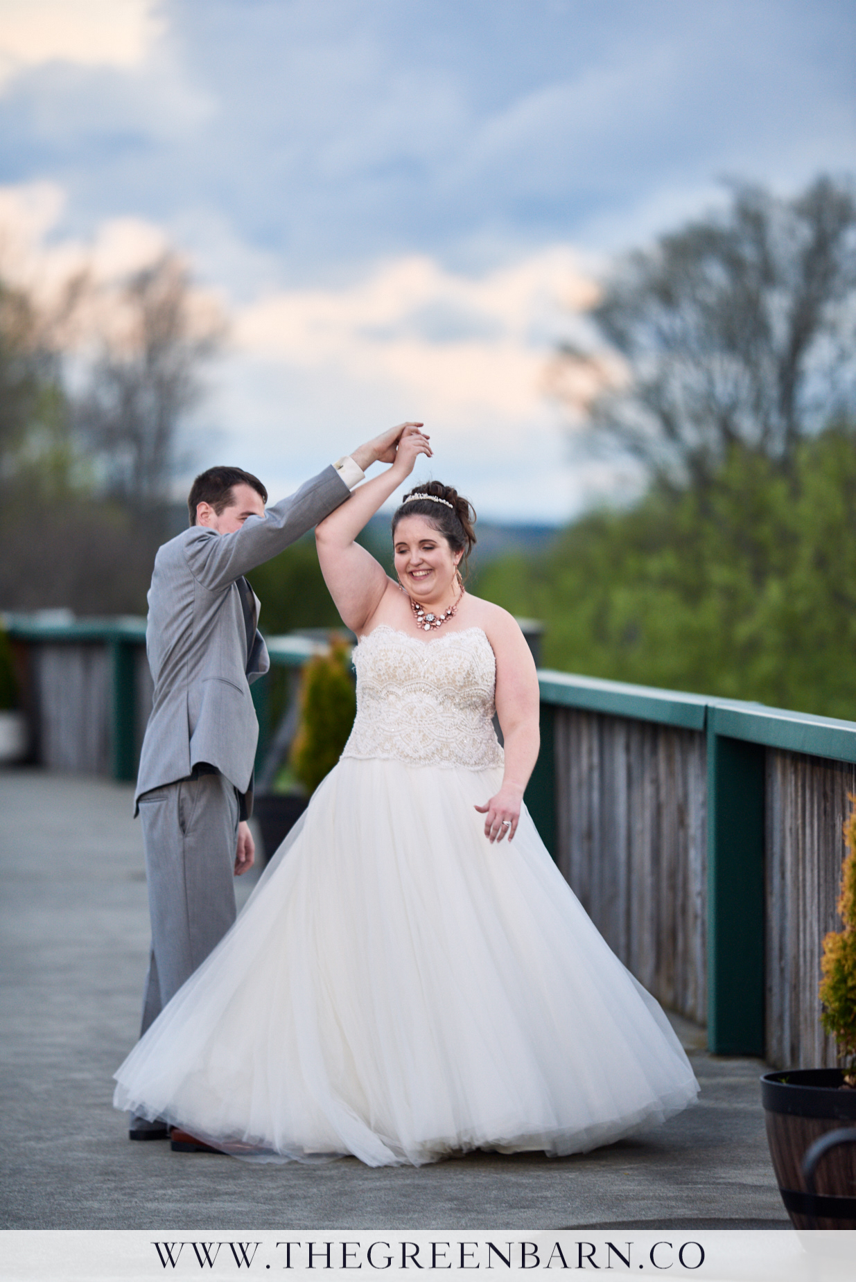 Bride and Groom Dancing Together at Sunset at their Country Club Wedding near Burlington, VT