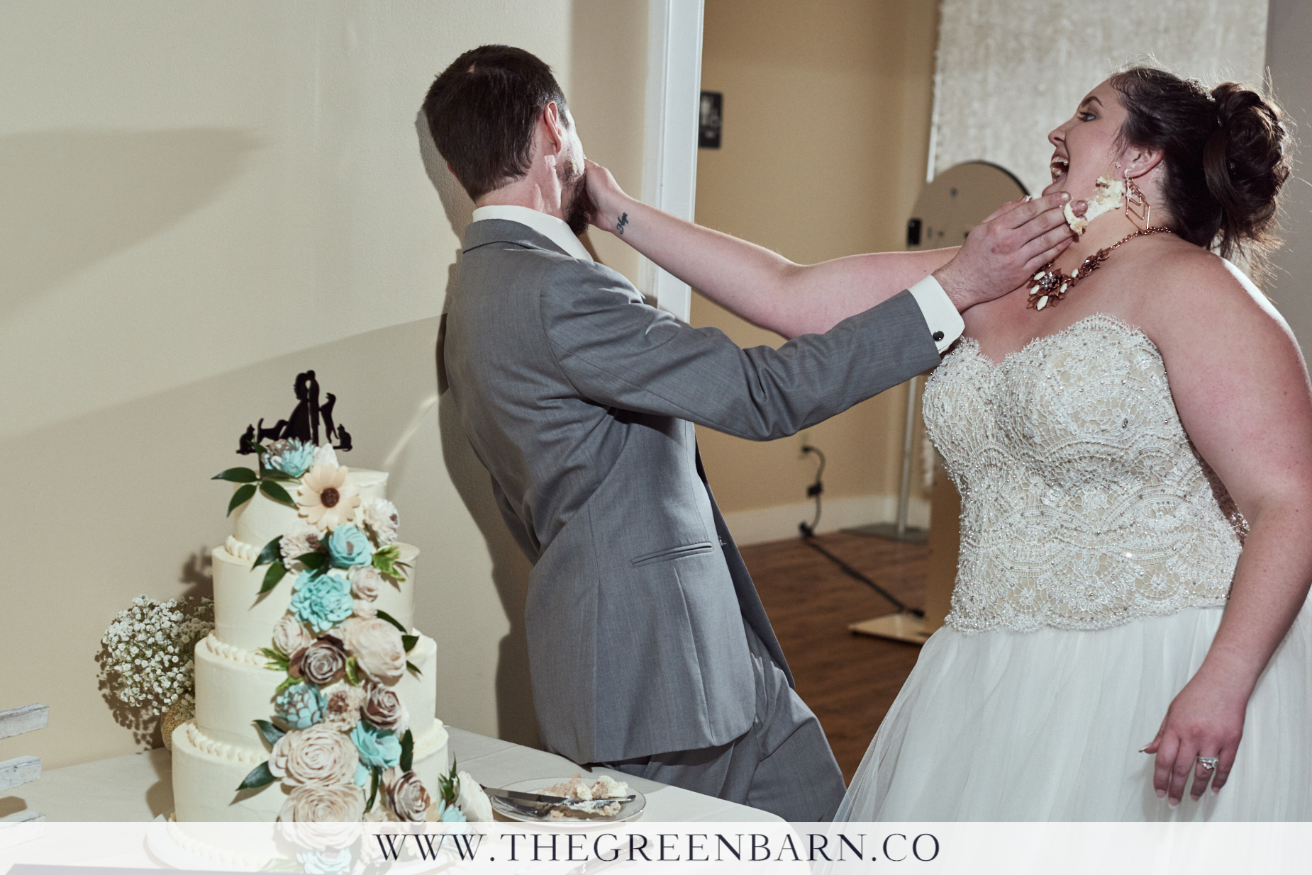 Bride and Groom Smash Cake into Each Other's Faces at this Fun Wedding near Burlington, VT