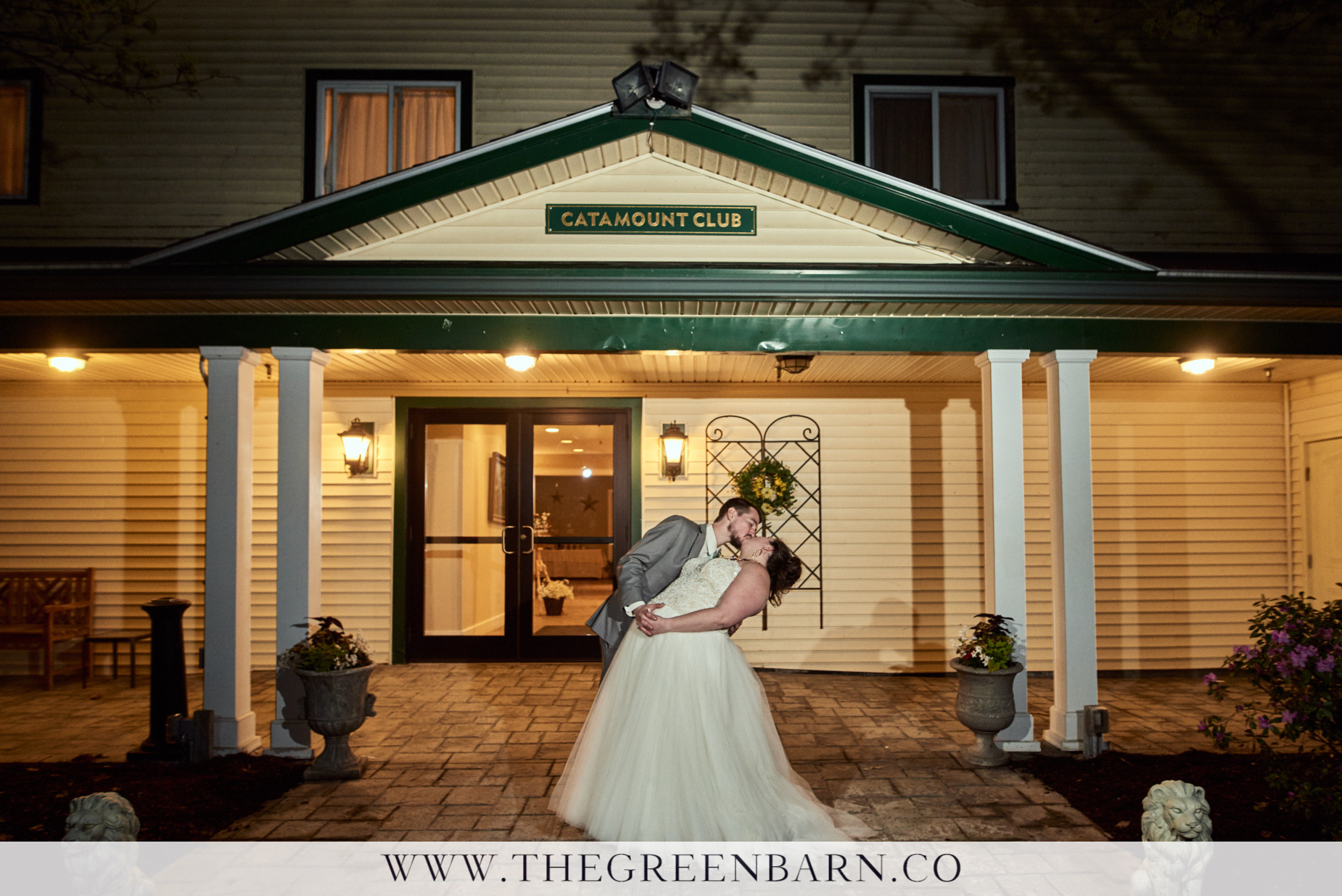 Bride and Groom Dip and Kiss at the Entrance to Catamount Country Club a Wedding Venue Near Burlington, Vermont