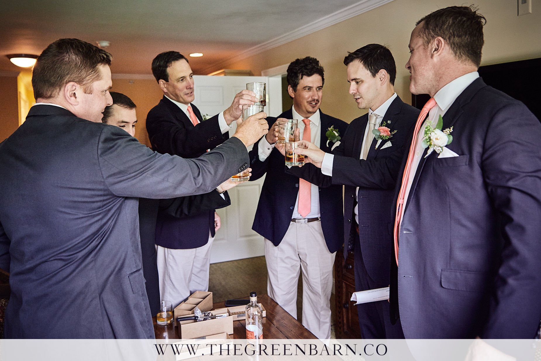 Groom and Groomsmen Cheers Their Whiskey Glasses Together Before the Wedding Ceremony | NH Wedding Photographer