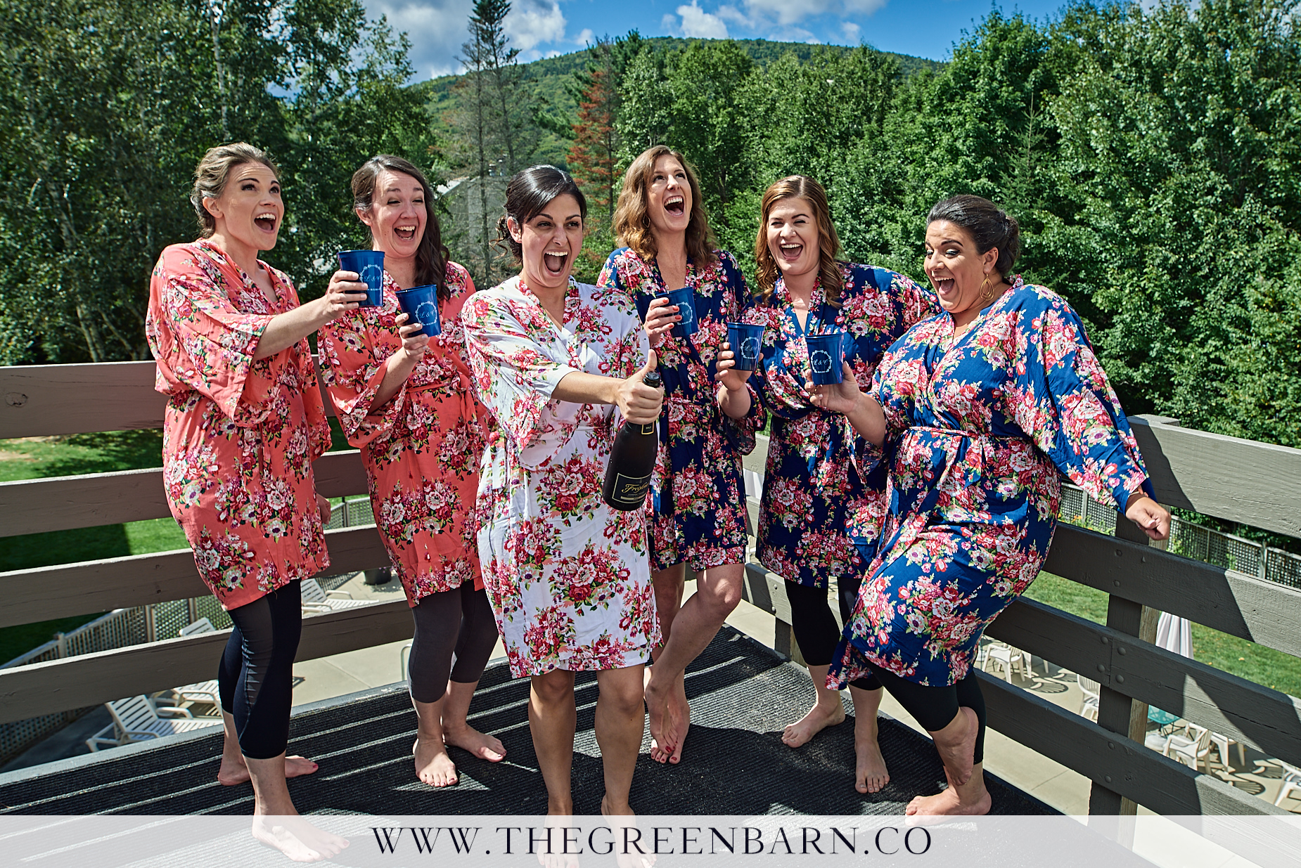 Bride Pops the Cork on a Bottle of Champagne with Her Bridesmaids | NH Wedding Photographer