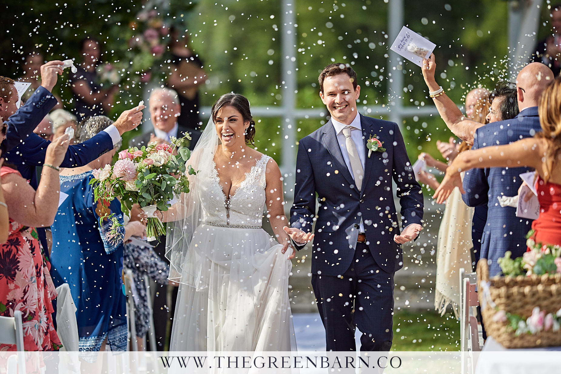 Bride and Groom Recessional Guests Throwing Confetti Photo | NH Wedding Photographer