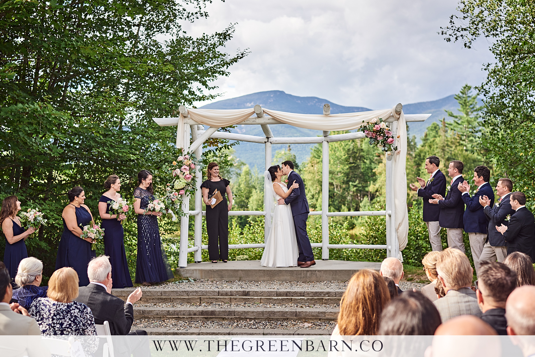 Bride and Groom First Kiss Photo at the Osceola Arbor in Waterville Valley | NH Wedding Photographer