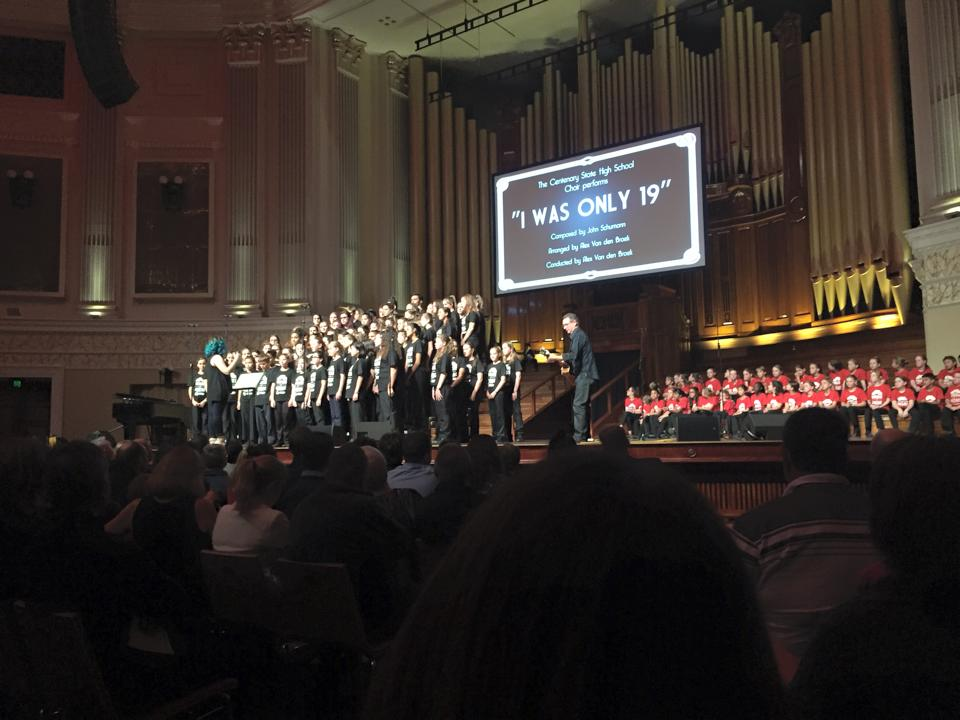 Conducting at Brisbane City Hall for the  Voices of ANZAC  Show, 2015 with guest guitarist Tim Gaze.