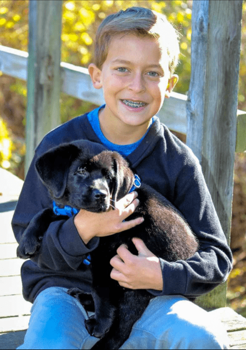 patient-with-puppy-and-braces-smiling.png