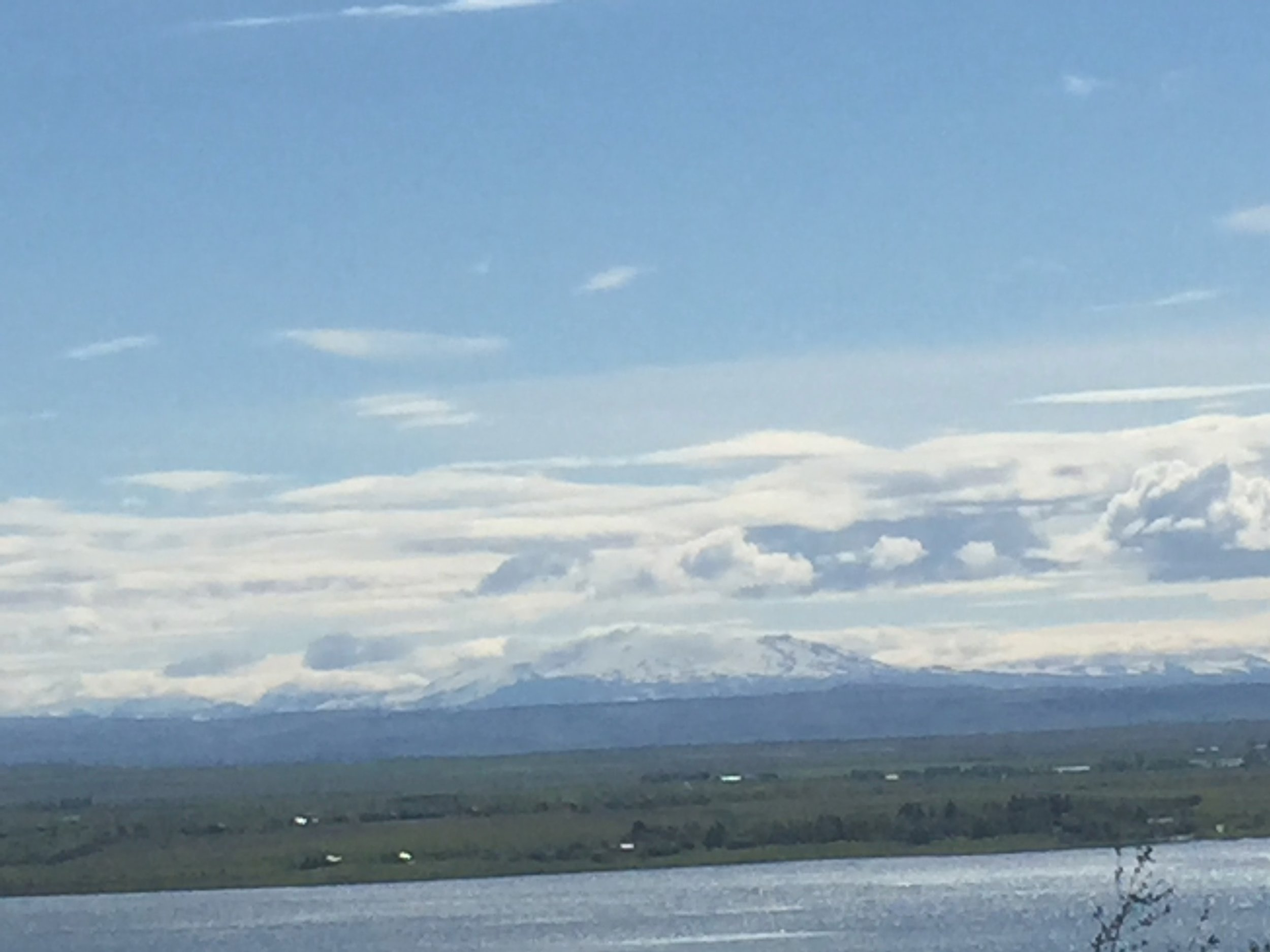 View from Studio across Lake at Laugarvatn. Rare sighting of Hekla without cloud-cover. Also due to erupt any time!