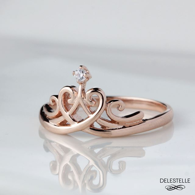 """We learn to hold our heads as if we wear crowns. We learn to wring magic from the ordinary"" Crown ring in 18K rose gold with diamond solitaire. #diamondring #rosegoldring #monogramring #personalizedring #likeaqueen #customring  #textring #namering"