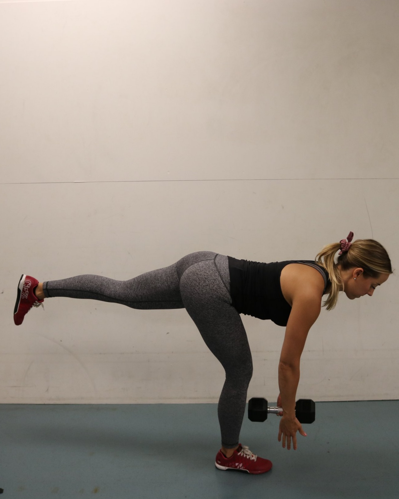 Keep knee soft and push hips back