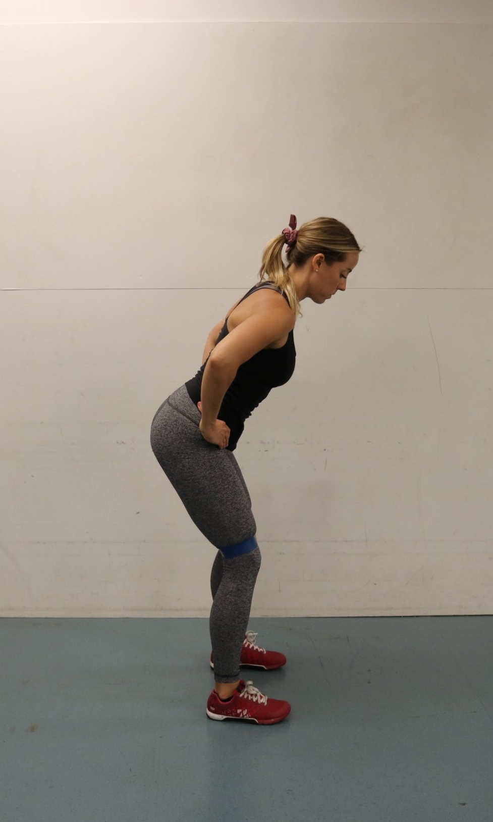 Maintain hip hinge position throughout