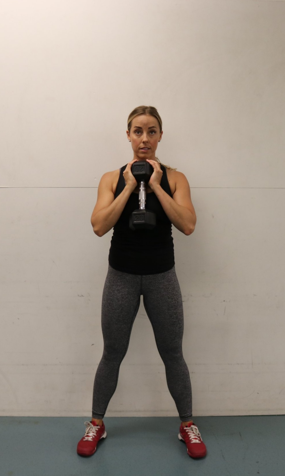 Top position, holding dumbbell in 'goblet' grip