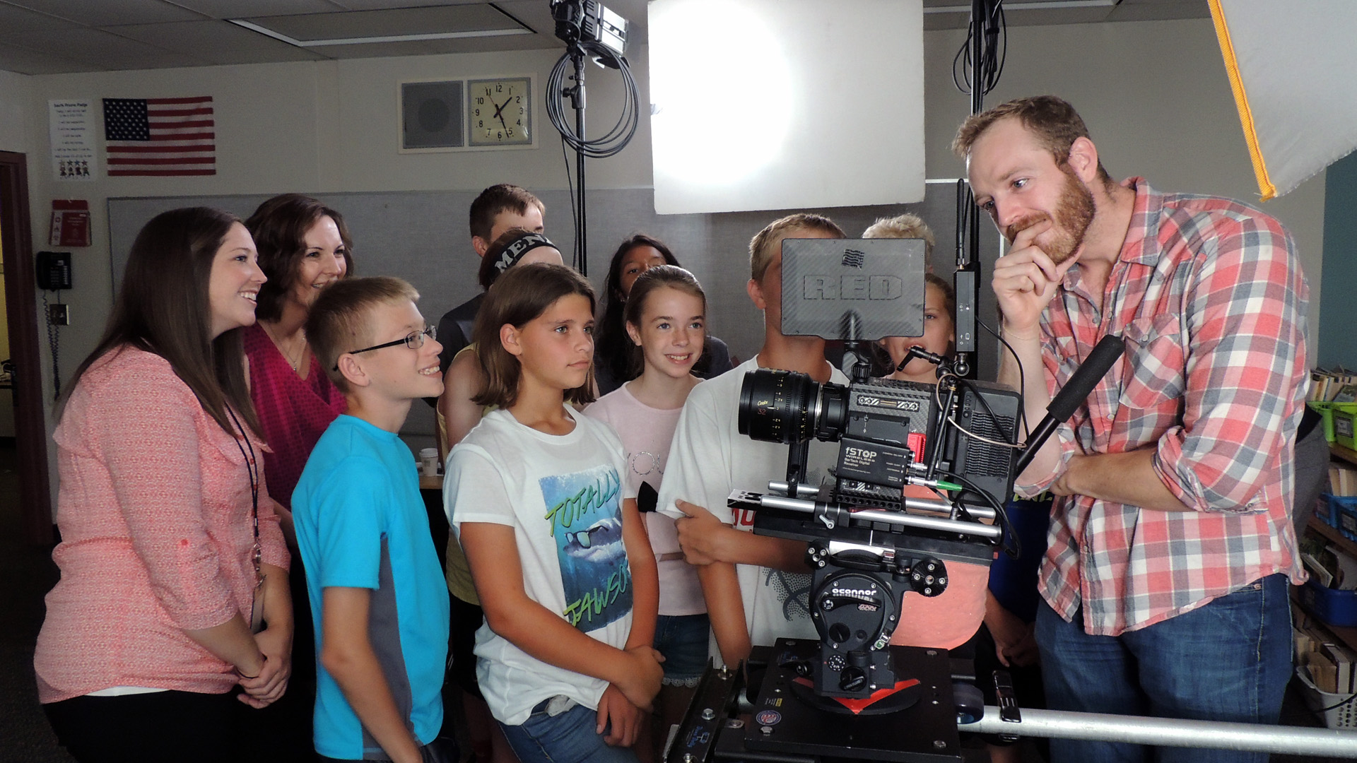 "These sixth and seventh graders from Grimes, Iowa were jazzed to help out with our production and had plenty of acting chops to showcase for the camera. In this shot, Scott assumes a classic ""pensive director"" pose as he reviews a crucial shot with the cast."