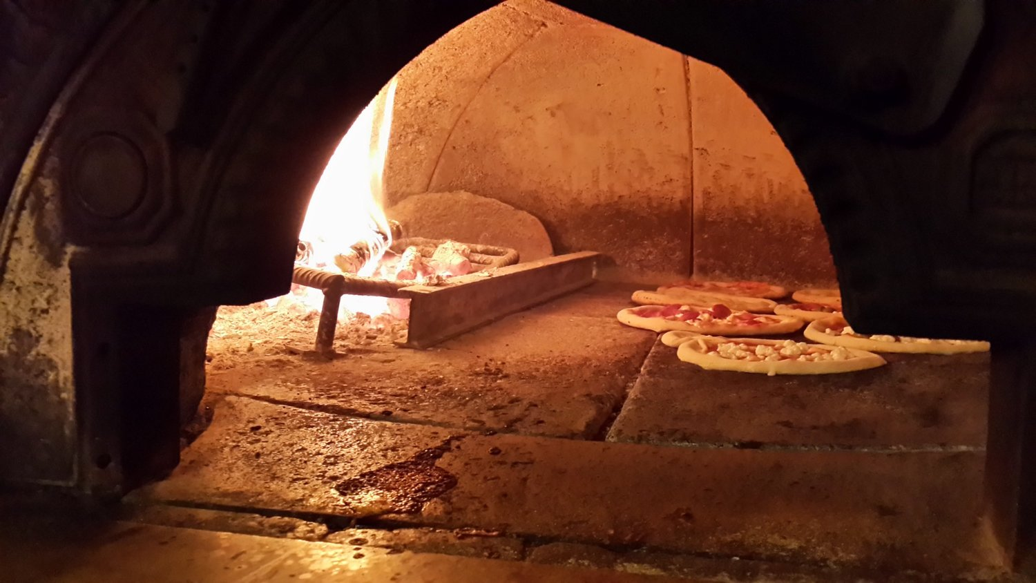Stone oven, still the most traditional and better way to bake pizza.