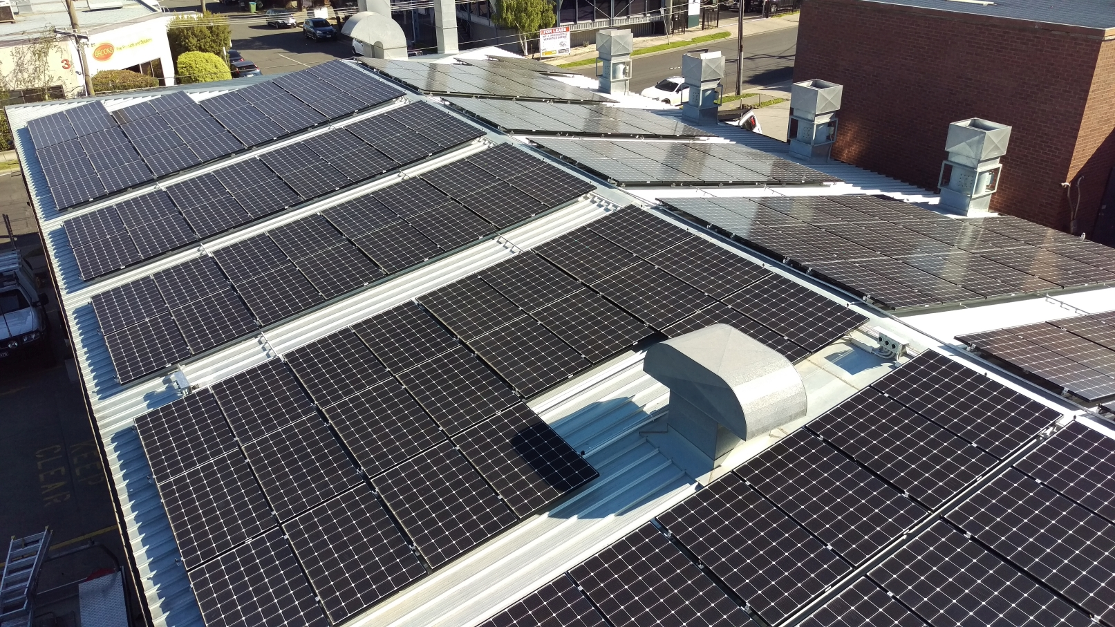 A 96kW commercial rooftop installation using LG Neon 2 330W panels and Tigo optimisers.