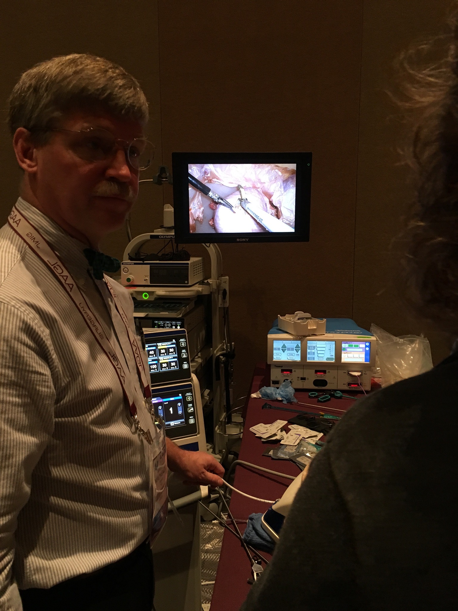 Holding the uterine manipulator for a surgeon working on a TLH Real Tissue Model.....