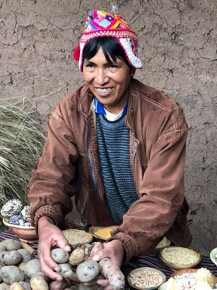 Elojidio demonstrates his variety of potatoes he grows on the farm.jpg