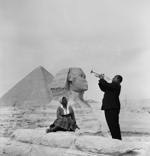 Louis Armstrong plays his trumpet in Egypt