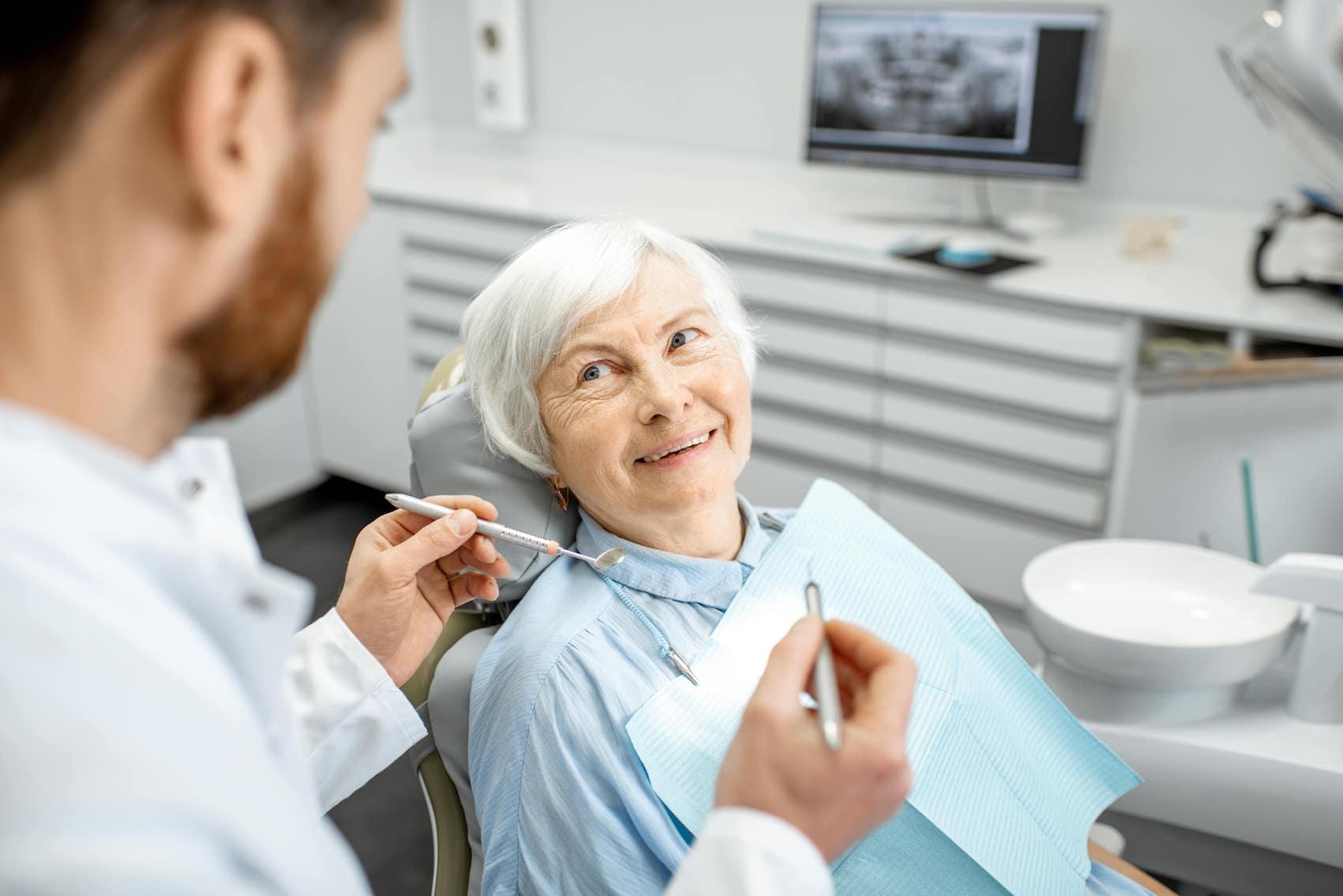 Dentist_checking_old_woman.jpeg