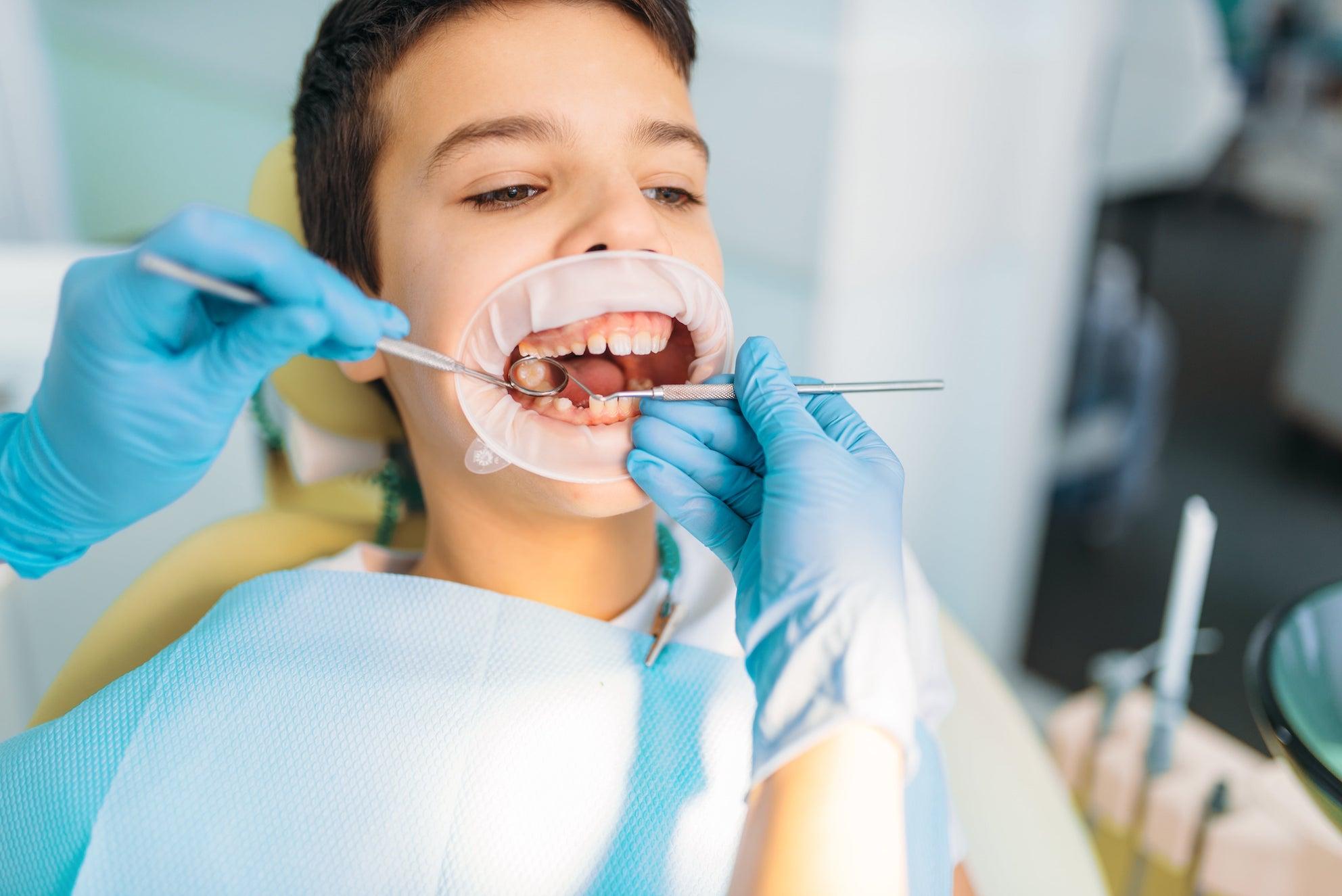 Dentist_checking_boy.jpeg