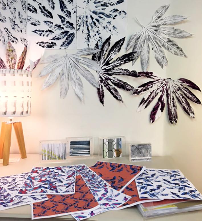 Studio shot of leaf designs and lamp