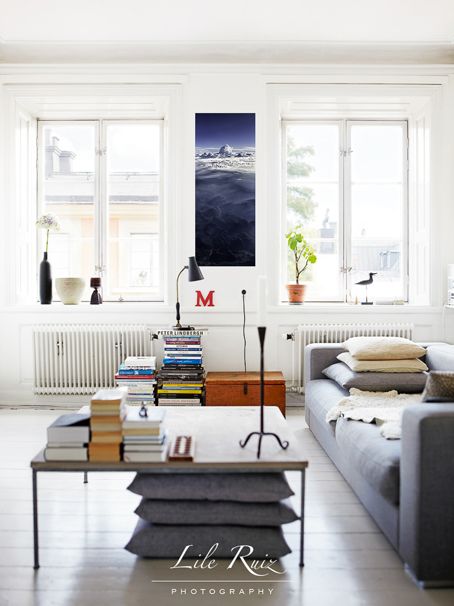 graphical-looking-living-room-with-stacks-of-books-adding-color1-nublancces-Edit.jpg