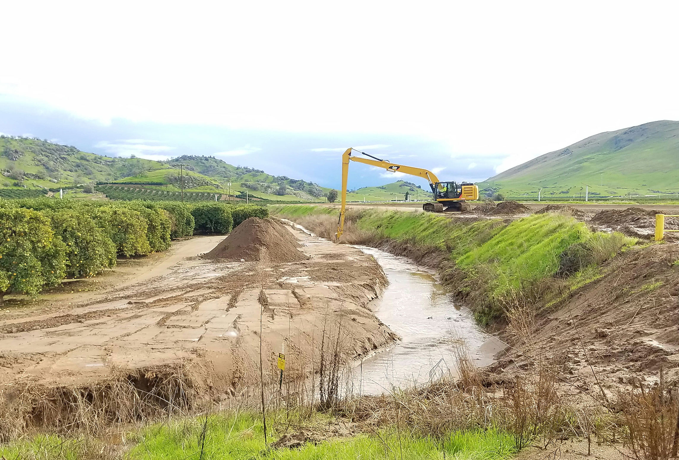 Drainage ditch being cleared of debris in the Orange Cove Section of the Friant Kern Canal