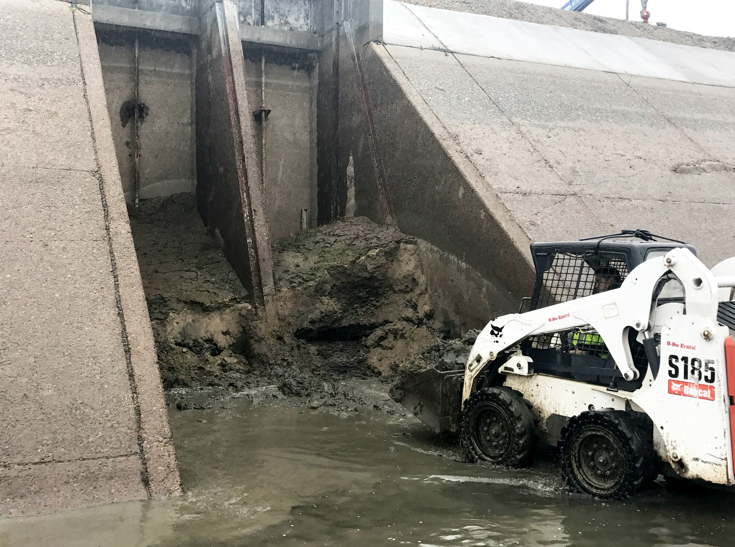 Turnout being cleared of silt and debris along the Friant Kern Canal