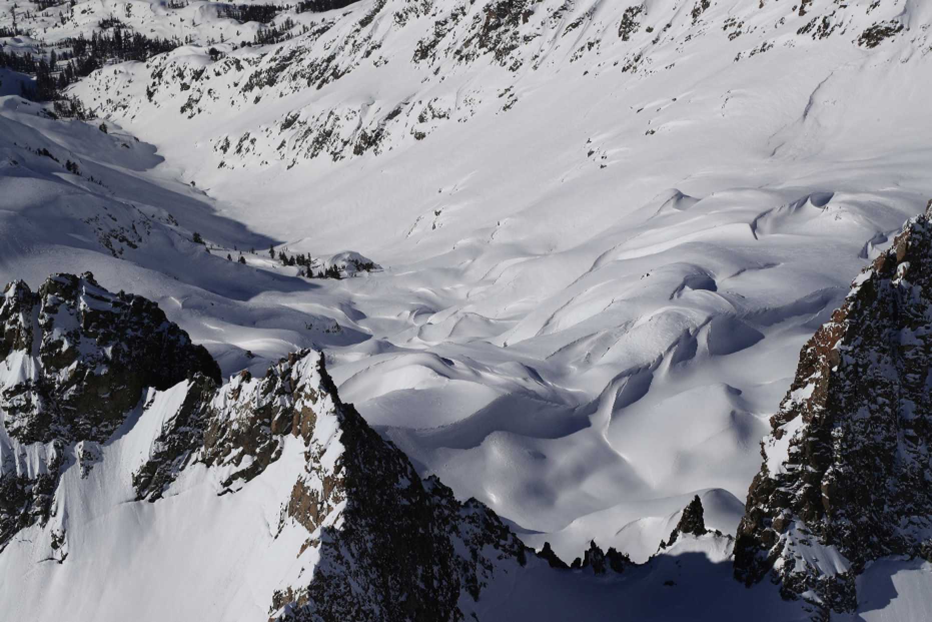 In 2017, the Friant-sponsored ASO surveys of the San Joaquin documented snow drifts with faces of 20 to 40 feet (pictured above) and snow-depths of over 90 feet, the deepest measured by the program to-date. (Photo credit: New York Times)