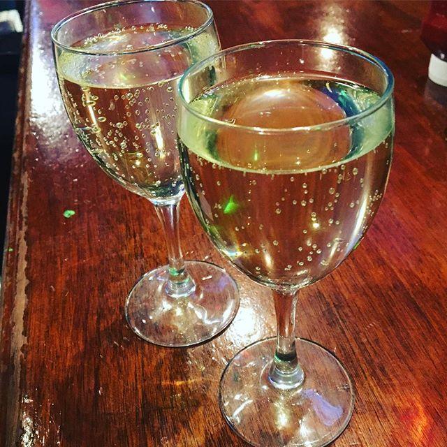 A little bubbly in a dive bar. #livin #celebrating #feelingood