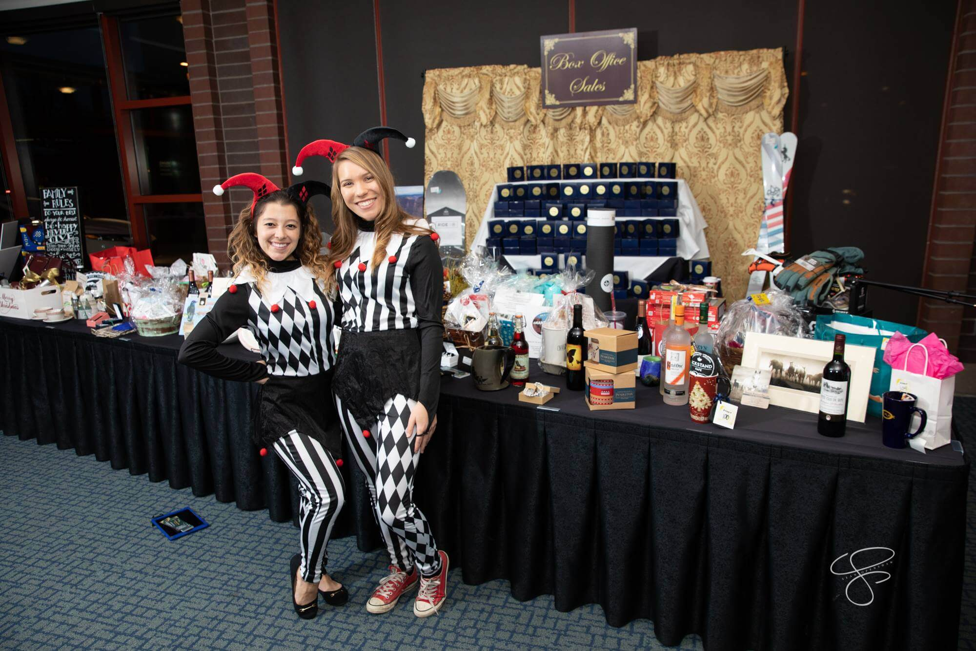 """Two NAU student volunteers at the 2018 Turquoise Ball, """"A Night at Versailles."""""""