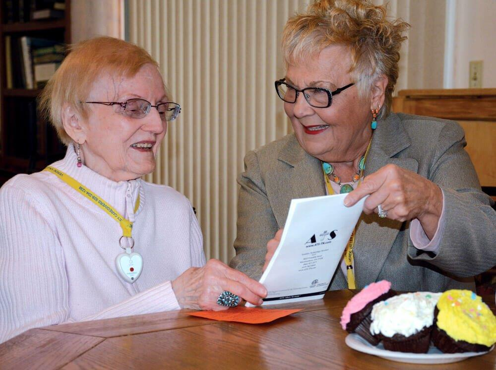 Volunteer Judy Fisher provides business help to Shirley, a VVCC neighbor. -