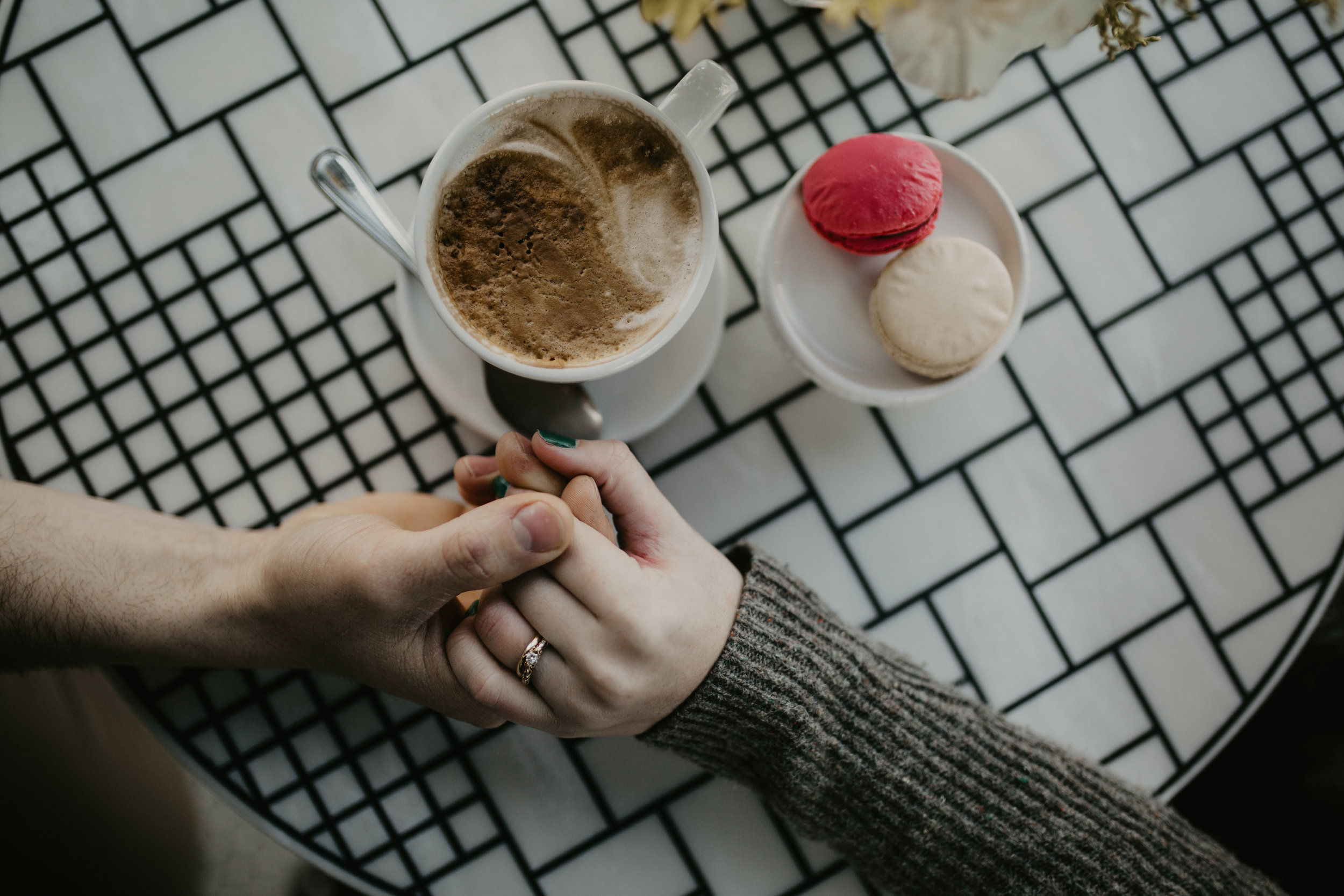 Flat lay shot of engagement ring and coffee