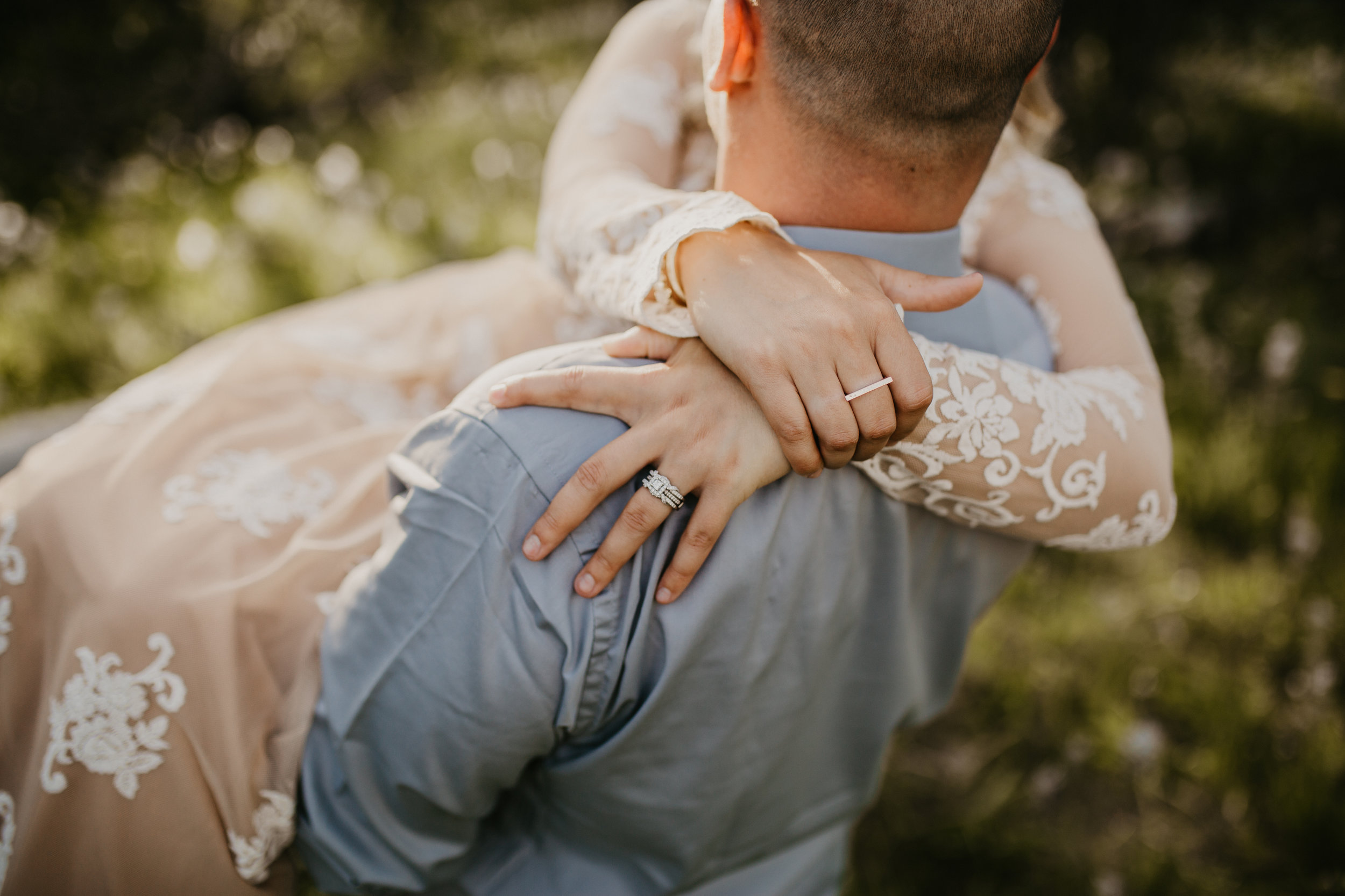 Groom holding his bride during engagement session in North Idaho