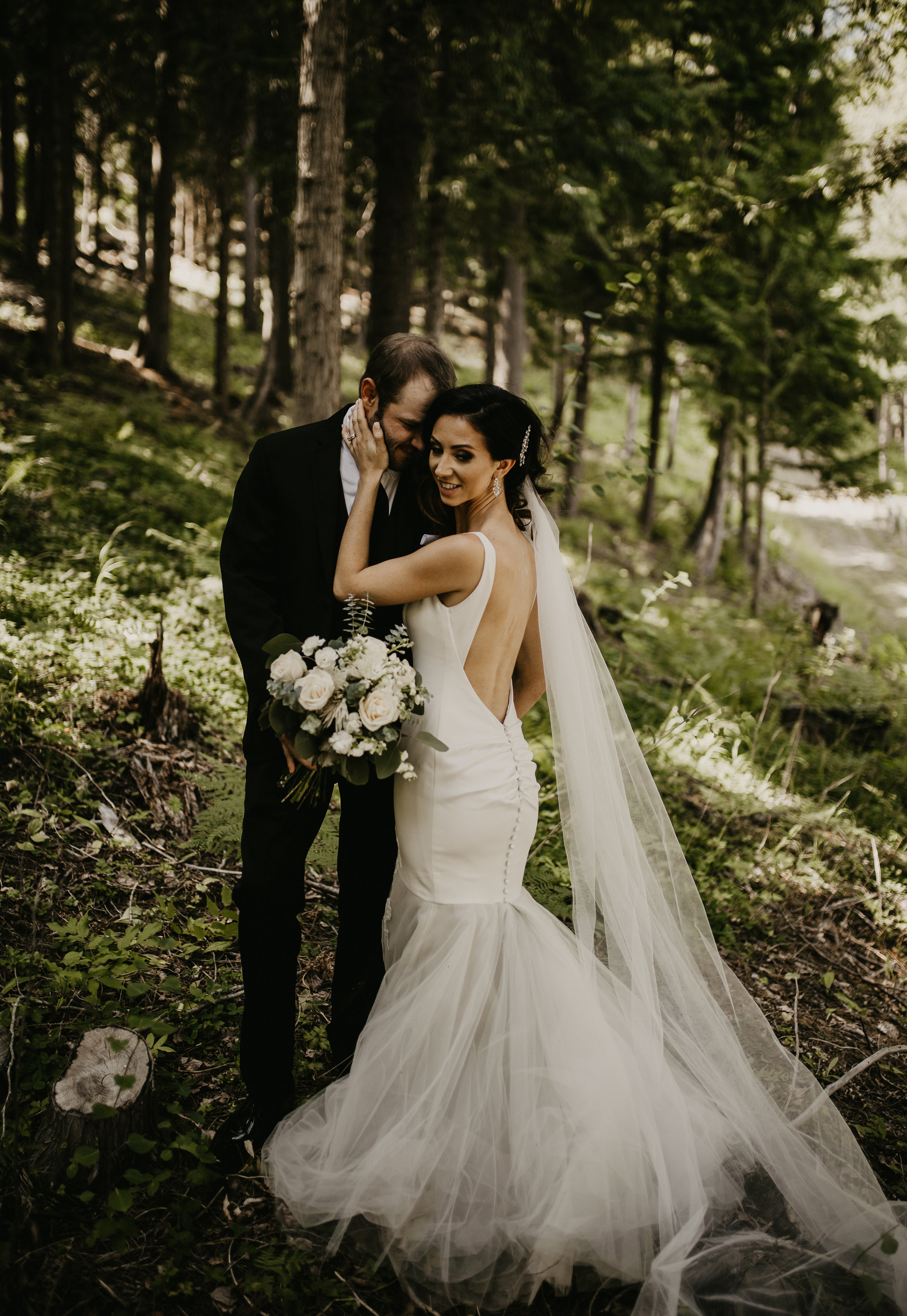 Bride and Groom standing in the forest during formal portraits