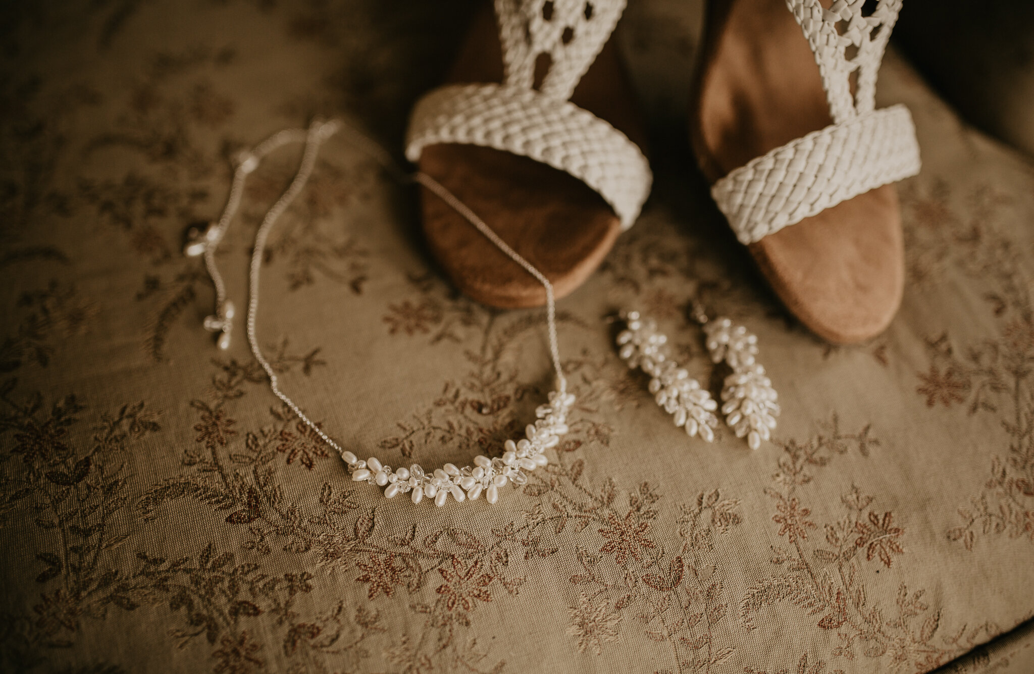 Brides jewelry and shoes for her wedding day