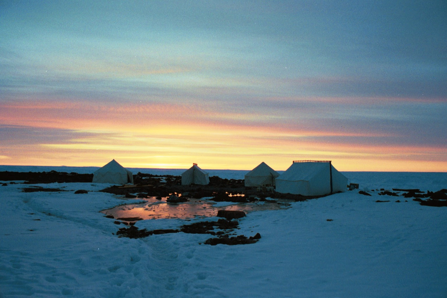 May sunset on our island research camp in Nunavut, in the eastern Canadian Arctic (2003; photo by Deb).