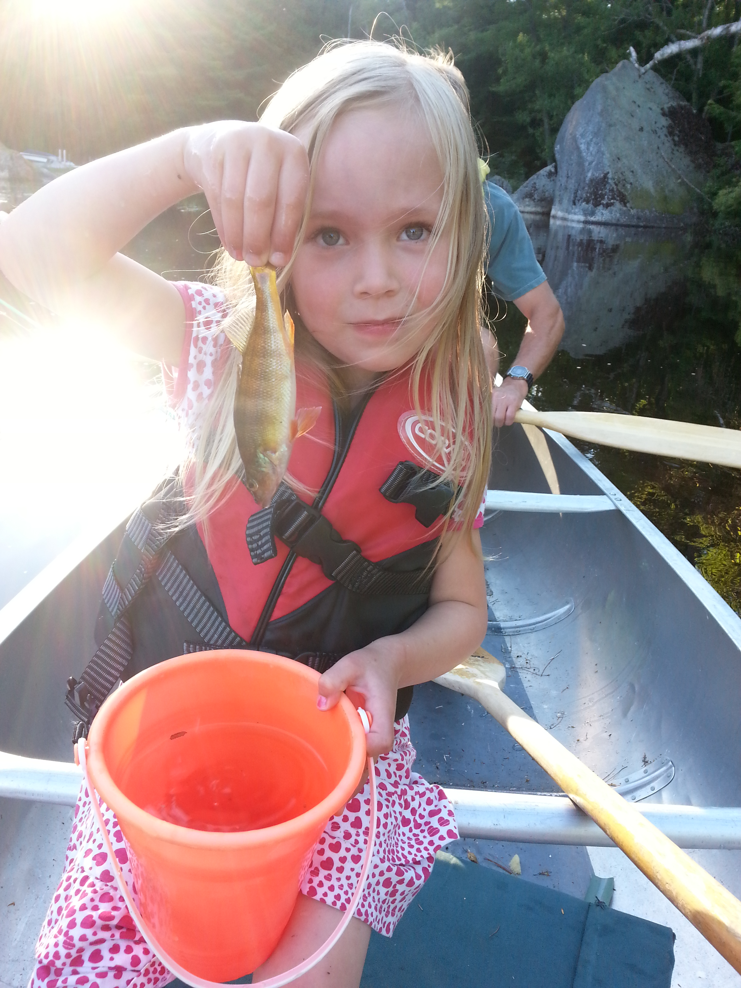 Deb's daughter Ada proudly displaying her first Green Lake catch (2013).
