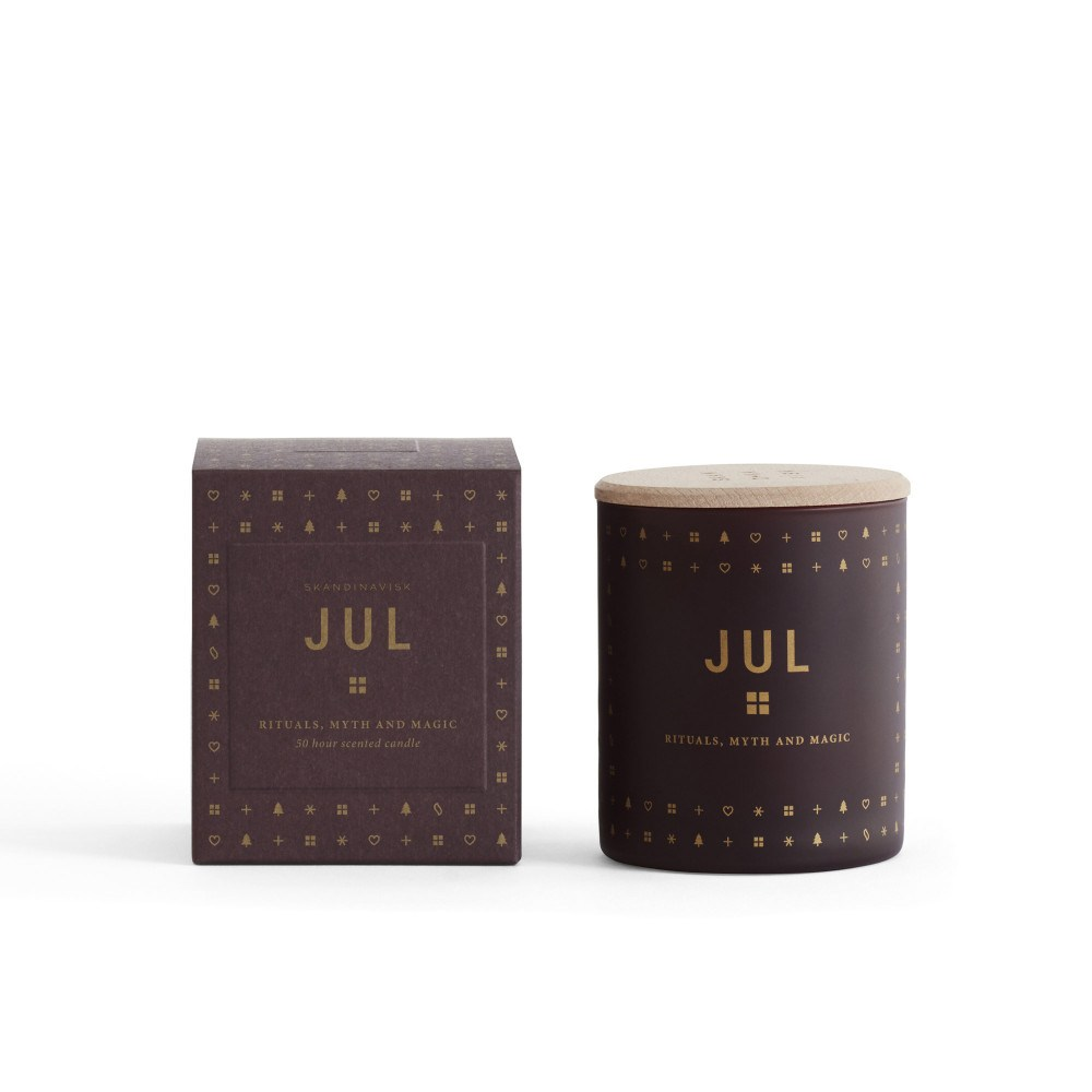 Jul (christmas) Scented Candle with notes of cinnamon, cloves and timberwood by Skandinavisk  Image Source : Skandium