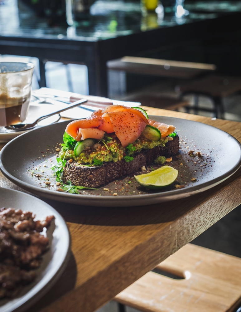 Aussie cafe Paramount Coffee Project coats a standard breakfast staple, smashed avocado toast, with slivers of smoked salmon and/or a poached egg.