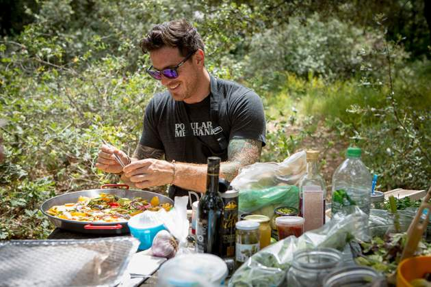 Seamus Mullen prepares a meal outdoors