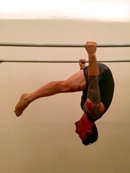 Seamus Mullen hanging working out in the gym