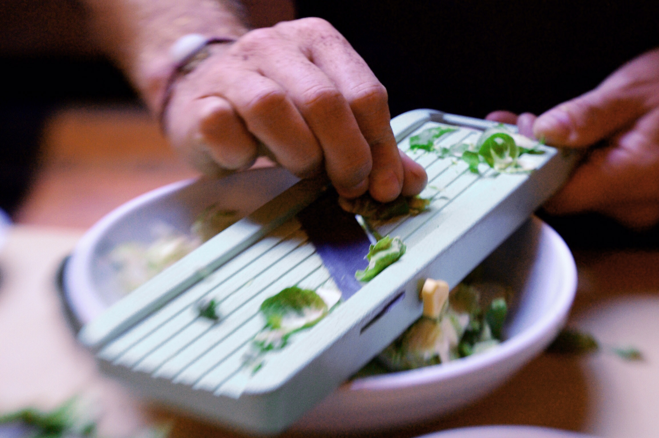 Shaving brussels sprouts with a mandoline